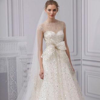 novia con vestido con brillos de Monique Lhuillier