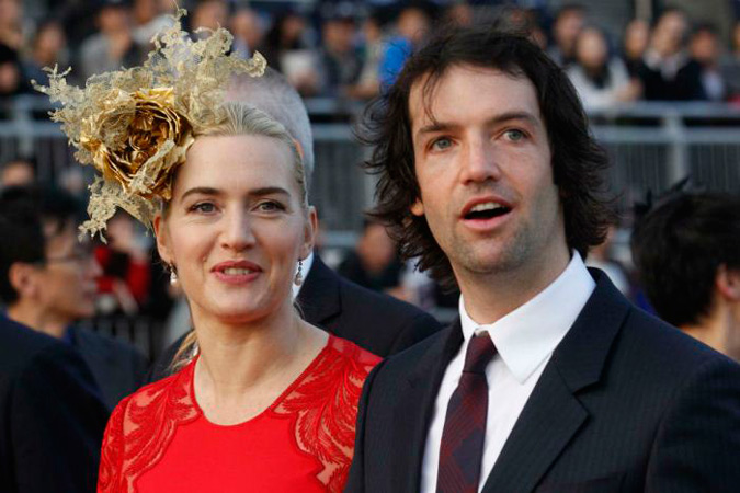 foto de pareja de Kate Winslet y Ned Rocknroll sobre la alfombra roja