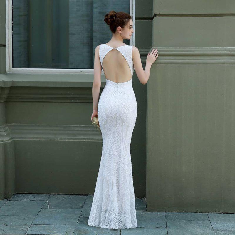 Vestido novia corte sirena decoraciones espalda descubierta