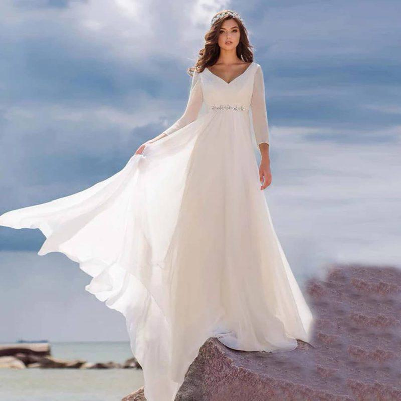 Vestido novia corte imperio manga larga escote V cinturilla decorativa