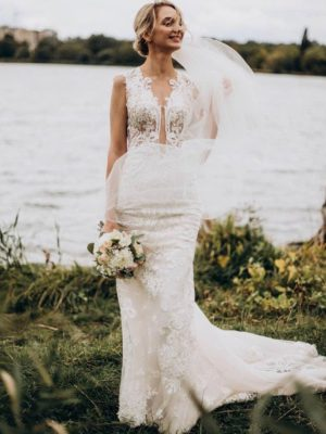 Vestido novia corte sirena escote forma V apliques encaje